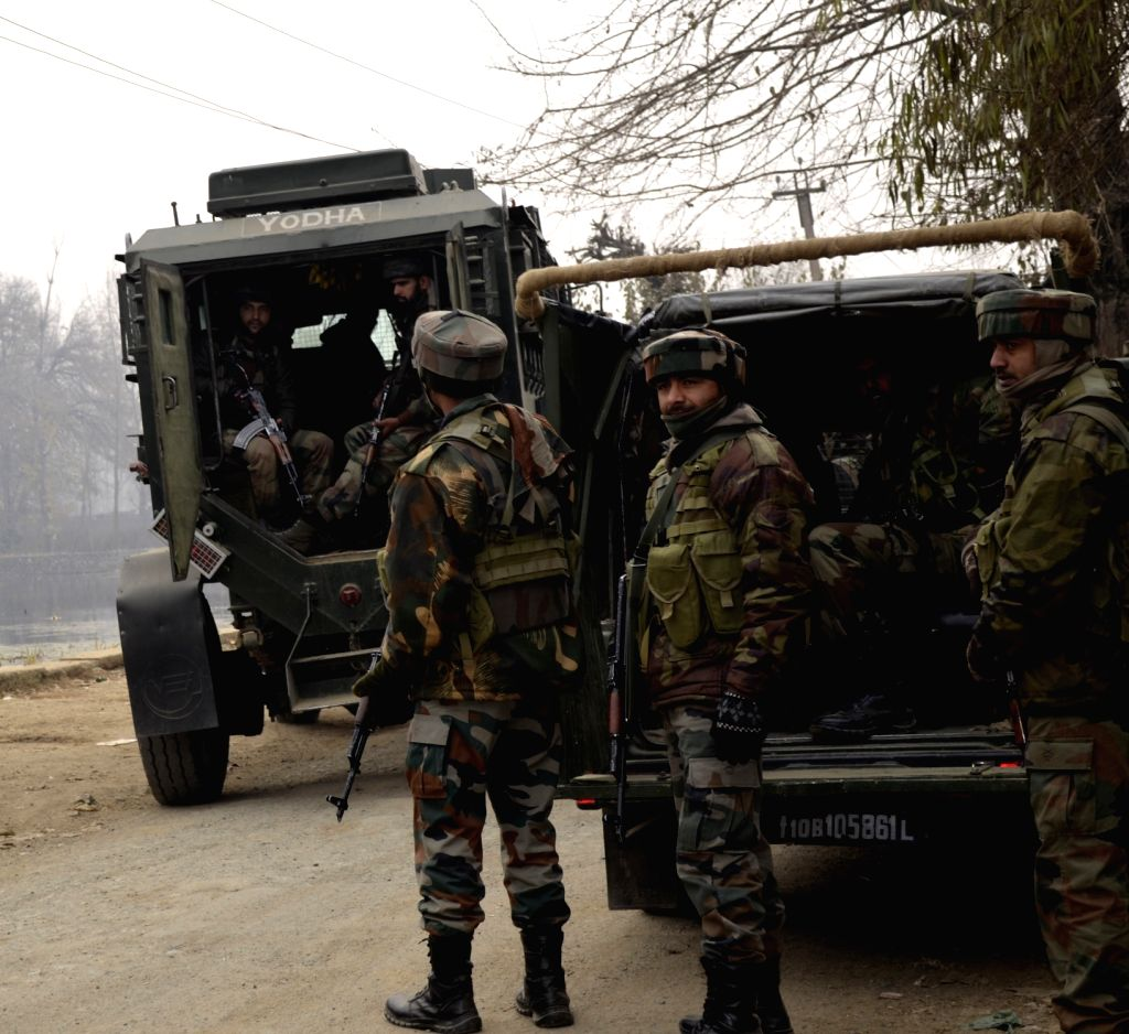 Soldiers in action during an encounter with militants at Manzpora village in Bandipoora district of Jammu and Kashmir on Nov 25, 2016. Reportedly a soldier and two militants were killed.