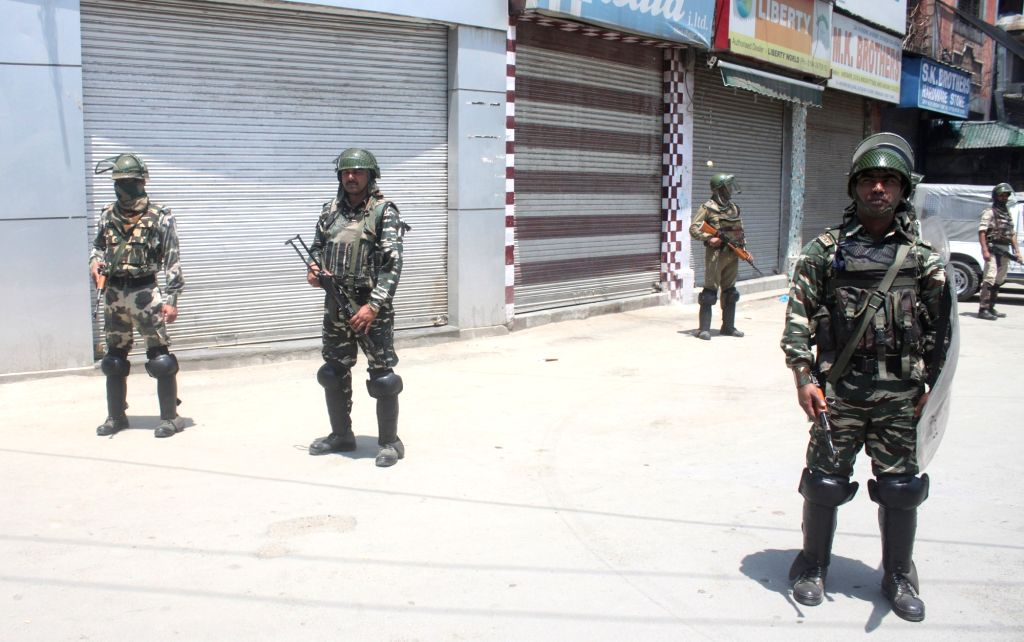 Soldiers man a Srinagar road as authorities clamp curfew and imposed restrictions in the Kashmir Valley to maintain law and order and prevent violence on May 28, 2017.
