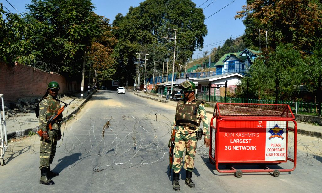 Soldiers man a street in Srinagar as authorities imposed restrictions in Srinagar to prevent a separatist called protest march to the UN observer's office.