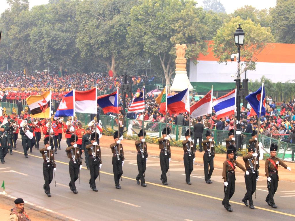Soldiers march on Rajpath holding the flags of ASEAN countries during full dress rehearsals for Republic Day Parade 2018 in New Delhi on Jan 23, 2018.