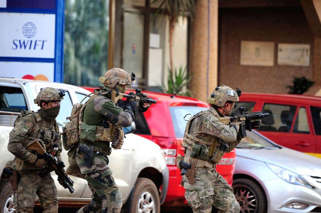 Soldiers of France and United States attend rescue campaign in Burkina Faso's capital Ouagadougou, Jan. 16, 2015. Twenty-three people have been killed and many ...