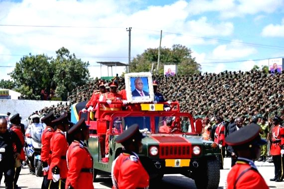 Soldiers on a ceremonial vehicle escort the casket of former Tanzanian President John Magufuli in Dodoma, capital of Tanzania, on March 22, 2021.