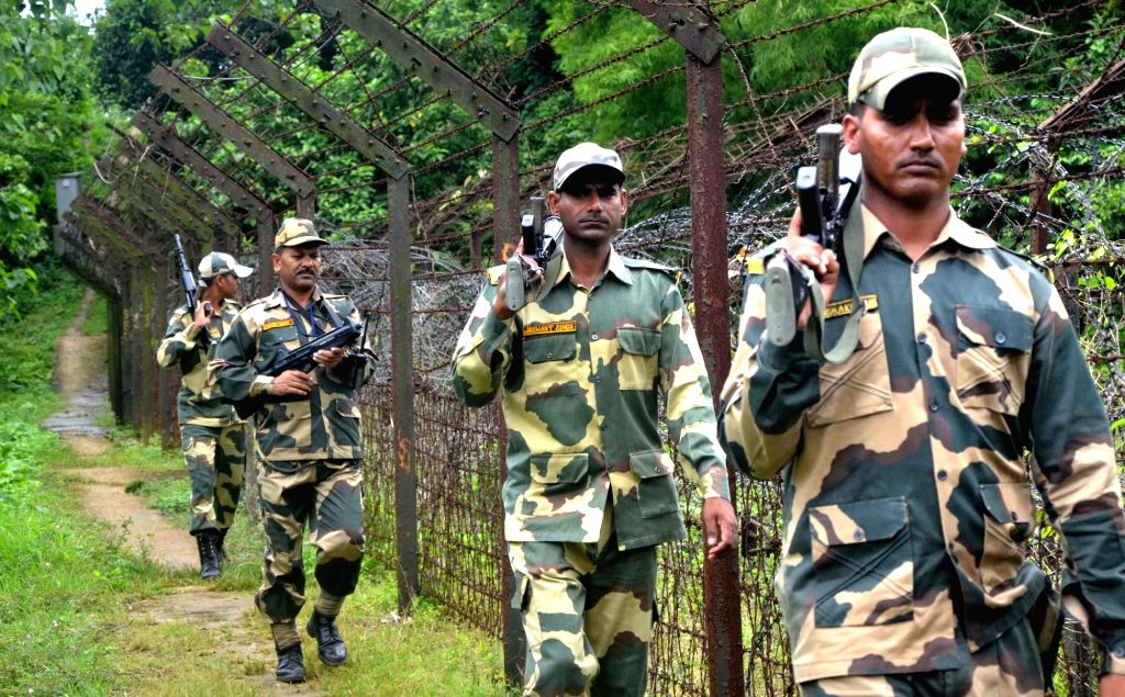Soldiers on patrol duty near Indo-Bangladesh border at Lankamura on the outskirts of Agartala on July 5, 2016.