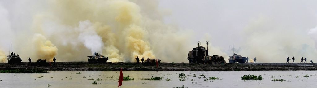 """Soldiers participate in """"Megh Prahar"""" - a military exercise organised to test the effectiveness of Indian Army's ultra modern Tank T-90 and BMP-2 in fighting across opposed river ..."""