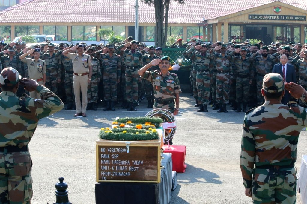 Soldiers pay their last respect to their colleagues killed in Uri terror attack, in Srinagar on Sept 19, 2016.
