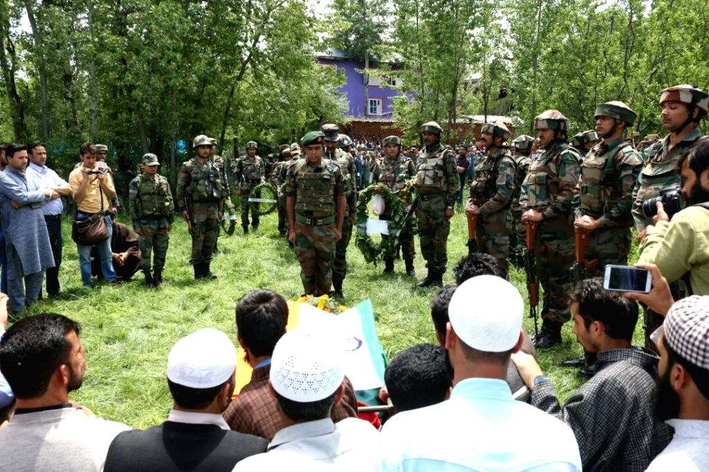Soldiers pay tribute to Lieutenant Ummer Faiyaz, who was found dead at  in Jammu and Kashmir's Shopian district on May 10, 2017. He was abducted by militants when he had gone to attend a ...