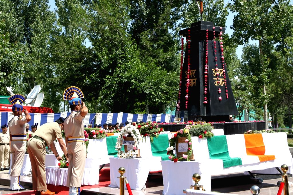 Soldiers pay tributes to the five Central Reserve Police Force (CRPF) troopers who were killed in a gunfight in Jammu and Kashmir's Anantnag district; at a wreath laying ceremony, in Budgam ...