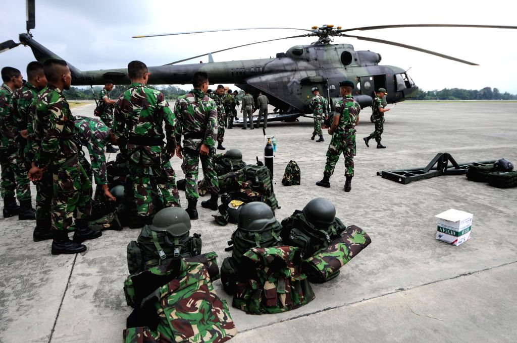 Soldiers prepare to leave for the Trigana Air Service flight's crash site for rescue operations, at an air base in Jayapura, Indonesia, Aug. 18, 2015. (Xinhua/Veri ...