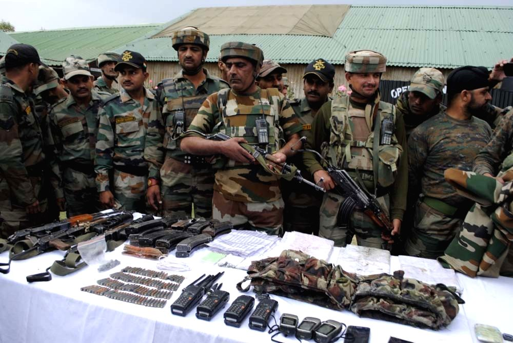 Soldiers present before press arms and ammunition recovered from the militants killed in north Kashmir's Kupwara district on Oct 6, 2016. Three heavily armed Pakistani terrorists dressed in ...