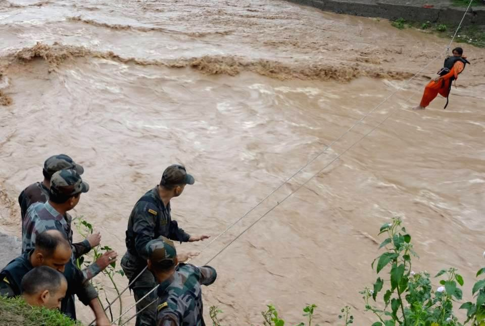 Soldiers rescue a woman trapped in flood hit Jammu and Kashmir on Sept 9, 2014.