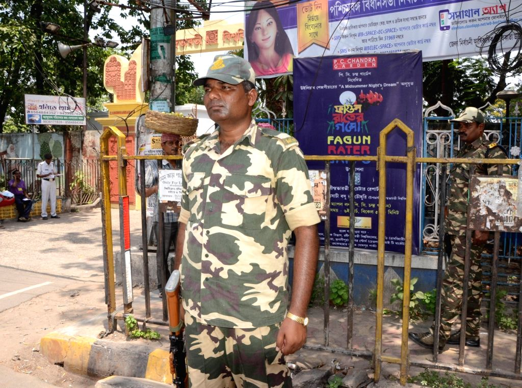 Soldiers stands guard at a polling station ahead of the thors phase of West Bengal Assembly polls in Kolkata on April 20, 2016.