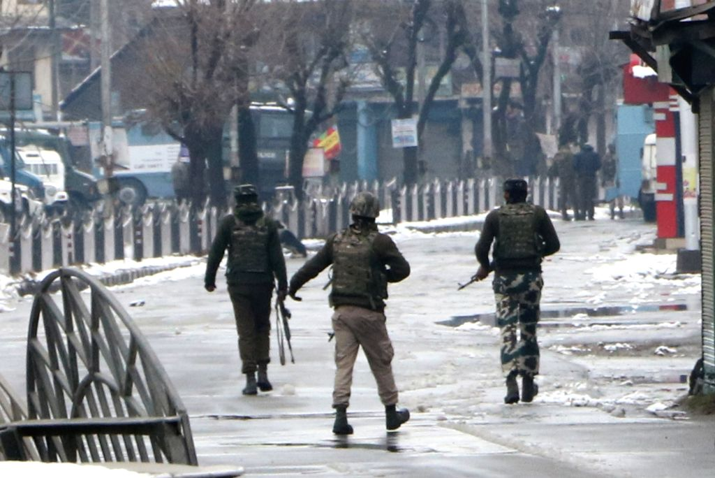 Soldiers take position after a gunfight erupted between militants and the security forces in Karan Nagar area of Srinagar Feb 13, 2018. Two holed up LeT militants, involved in a failed ...