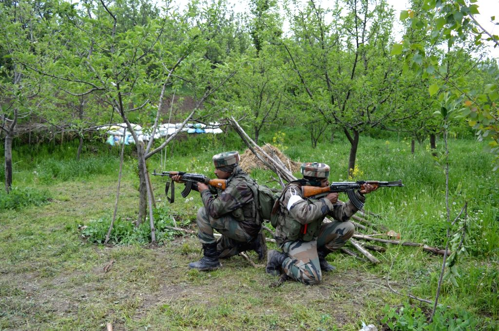 Soldiers take position during a gunfight with security forces in Jammu and Kashmir's Pulwama district on Aug 9, 2017. Three militants were killed in the gunfight.