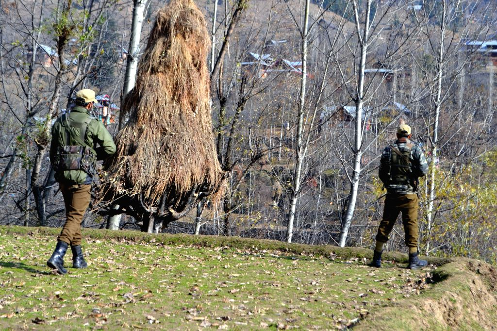 Soldiers take position during an encounter with militants in Manigah of Jammu and Kashmir's Kupwara district on Nov 27, 2015.