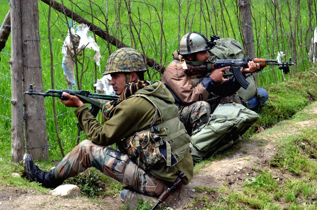 Soldiers take position during an encounter with militants in Lolab of Jammu and Kashmir, on April 21, 2016.