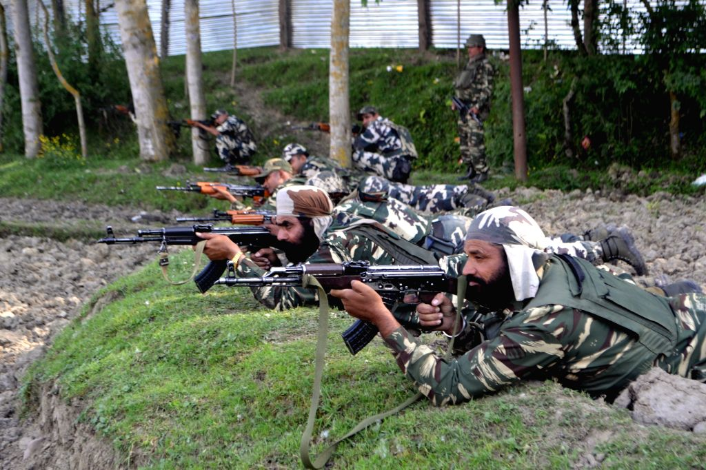 Soldiers take position during an encounter with militants at Drugmulla near Kupwara in Kashmir on May 21, 2016.
