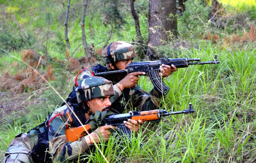Soldiers take position during an encounter with militants in Pulwama on May 27, 2017. Hizbul Mujahideen commander, Sabzar Bhat who succeeded slain militant, leader Burhan Wani, was killed ...