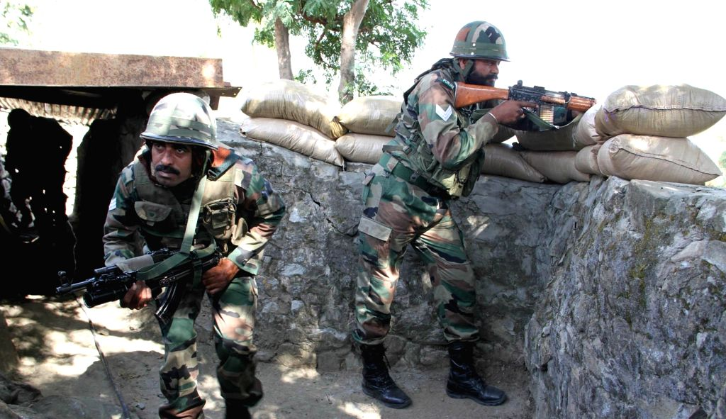 Soldiers take position in their bunker at Naushera sector of Jammu and Kashmir where Pakistani forces resorted to heavy firing on Oct 28, 2016.