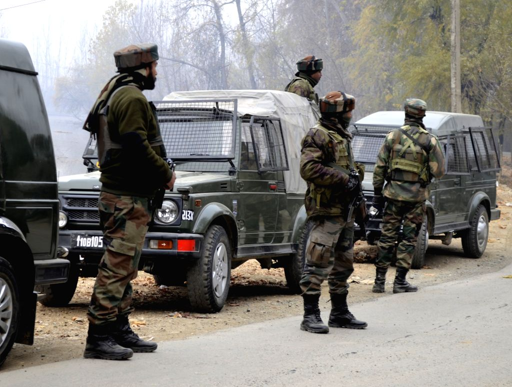 Soldiers takes position in north Kashmir's Kupwara district where militants attacked a BSF convoy on Nov 26, 2015.