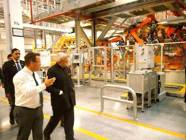 :Solihull: Prime Minister Narendra Modi visits Jaguar Land Rover (JLR) plant, a subsidiary of India's Tata Motors at Solihull, UK on Nov 14, 2015. (Photo: IANS/Twitter). - Narendra Modi