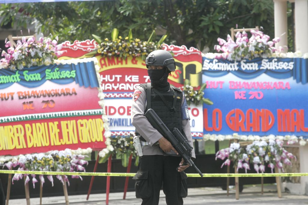 SOLO, July 5, 2016 - A policeman stands guard at the site of a suicide bombing at a police station in Solo, Central Java, Indonesia, July 5, 2016. A suicide bomber blew himself up at a police station ...
