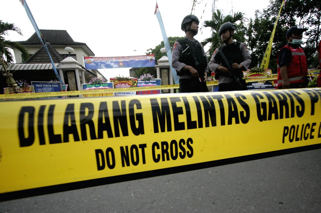 SOLO, July 5, 2016 - Policemen stand guard at the site of a suicide bombing at a police station in Solo, Central Java, Indonesia, July 5, 2016. A suicide bomber blew himself up at a police station in ...