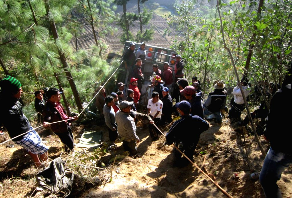 SOLOLA, March 28, 2016 - Rescuers work at the site of the rollover of a passenger bus in the municipality of Nahuala, department of Solola, Guatemala, on March 28, 2016. At least 19 people died and ...