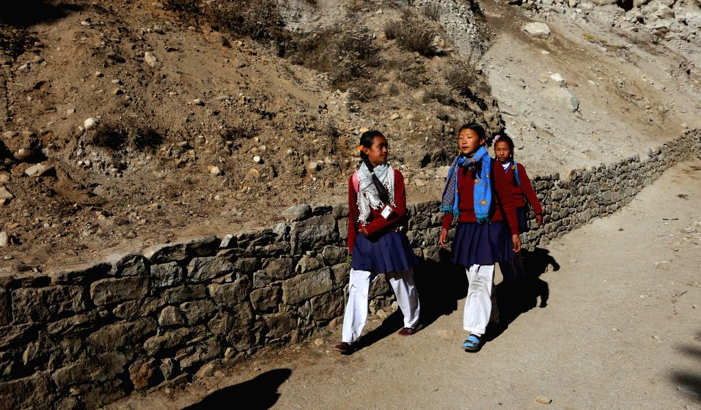 SOLUKHUMBU, Nov. 27, 2016 - Local girls are on their way to school at a village of Toktok, Khumbu region in Solukhumbu, Nepal, Nov. 18, 2016. Children's education in this region is affected by the ...