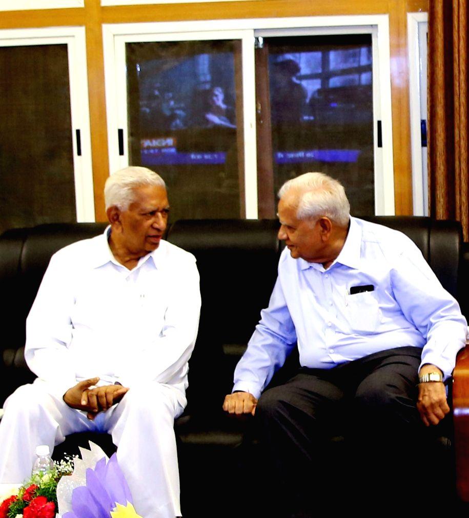 Somabhai Modi, the eldest brother of Narendra Modi calls on the Karnataka Governor Vajubahi Rudabhai Vala in Bengaluru on July 5, 2016. - Narendra Modi and Somabhai Modi