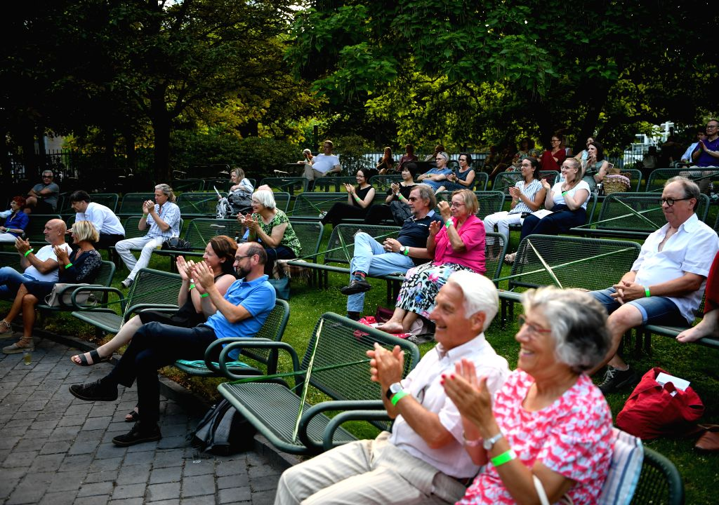 Some seats are taped to ensure social distancing during an outdoor concert at Palm Garden in Frankfurt, Germany, August 1, 2020. A series of concerts are held here ...