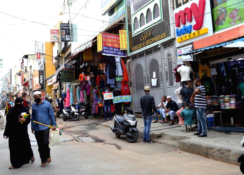 Some shops in residential complexes open in Bengaluru after certain restrictions were relaxed by the state authorities during the extended nationwide lockdown imposed to mitigate the ...