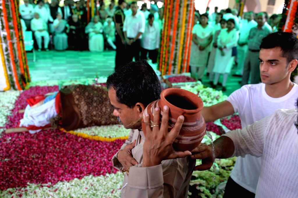 Son of President Pranab Mukherjee, Abhijit Mukherjee at the cremations of first lady Suvra Mukherjee at the Lodhi Road crematorium in New Delhi, on Aug 19, 2015. - Pranab Mukherjee and Abhijit Mukherjee