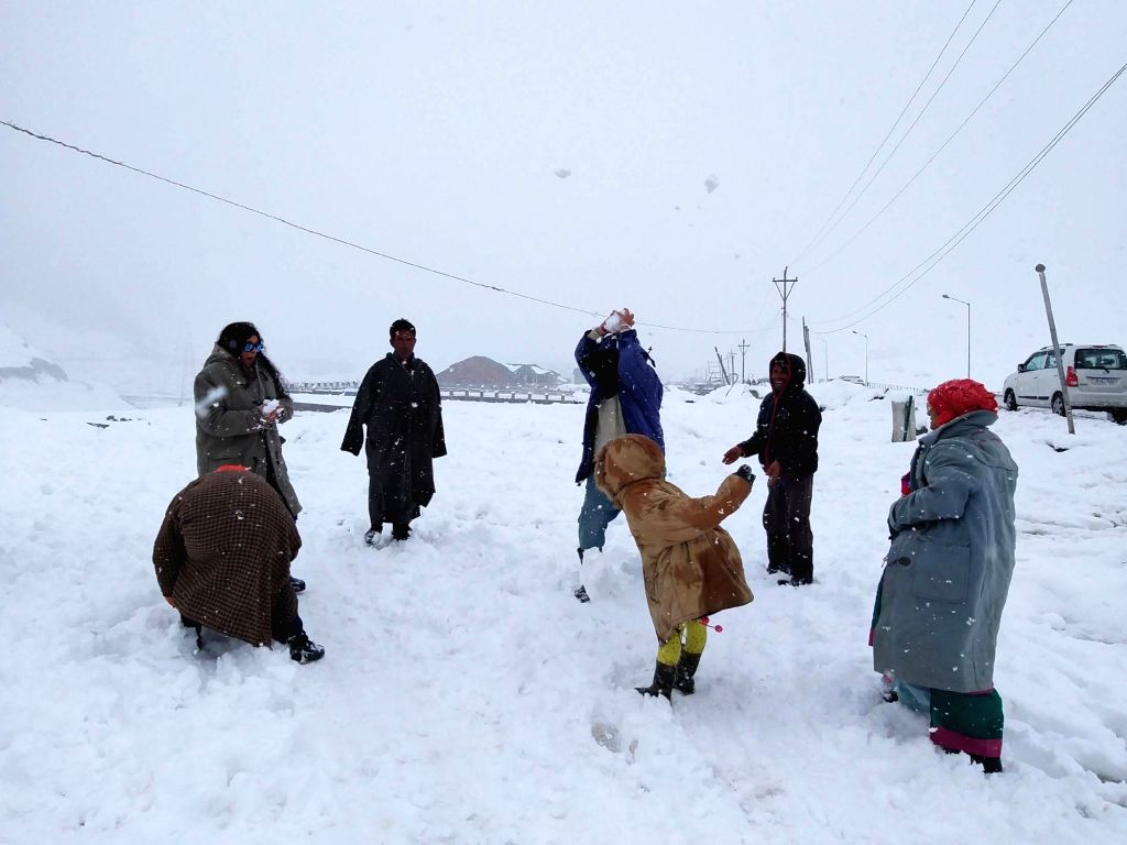 Sonamarg: People play with snow as Jammu and Kashmir's Sonamarg receives the season's first snowfall on Nov 3, 2018. Fresh snowfall occurred in the higher reaches of Jammu and Kashmir including Zojila Pass, Drass, Kargil, Sonamarg, Pahalgam and Gulma