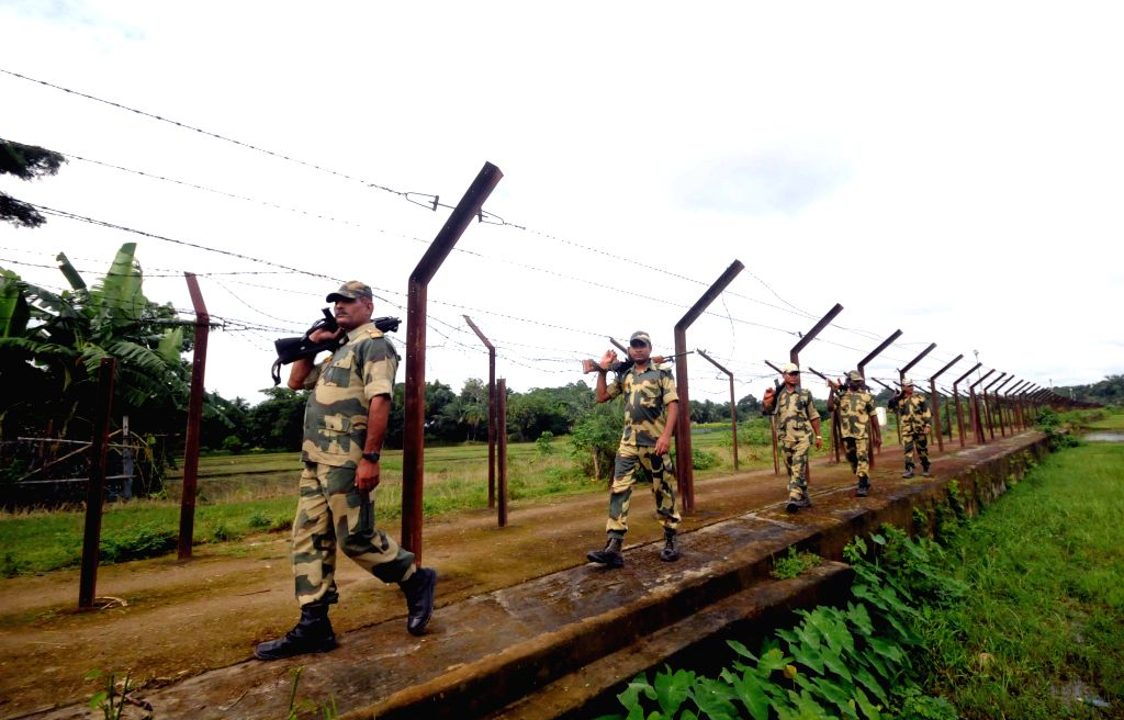 Sonamura: BSF personnel on patrol duty at Indo-Bangladesh border in Sonamura area of Tripura after fencing work was stalled due to some dispute on July 23, 2015. (Photo: IANS)