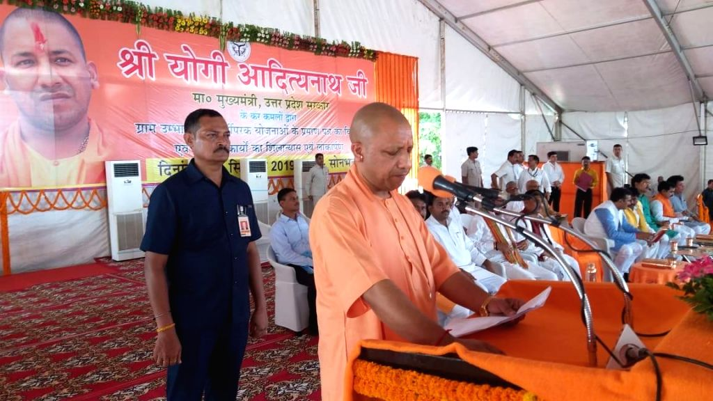 Sonebhadra: Uttar Pradesh Chief Minister Yogi Adityanath addresses during a programme where he handed over land documents to 281 local residents, in Uttar Pradesh's Sonebhadra district, where 11 tribals had been killed on July 17 in a land dispute; o - Yogi Adityanath