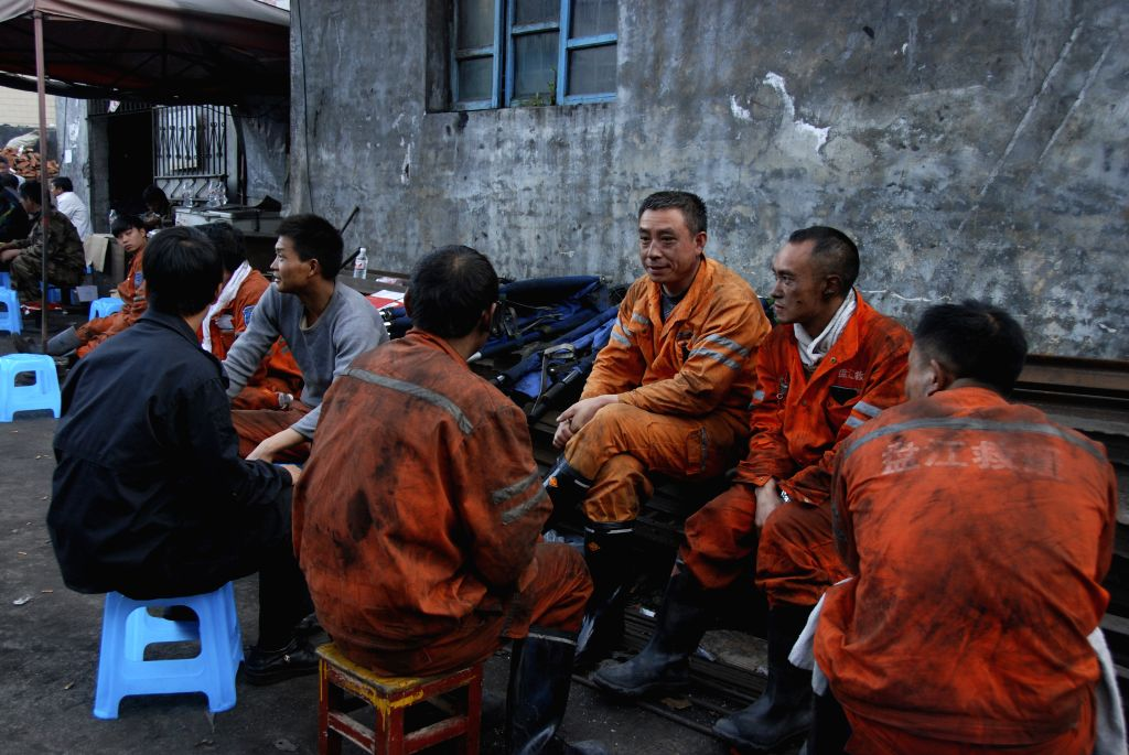 Songhe (China): Rescuers rest at the accident site in Songlin coal mine in Songhe Town of Panxian County, southwest China's Guizhou Province, Nov. 27, 2014. A total of 11 people were killed in an ...