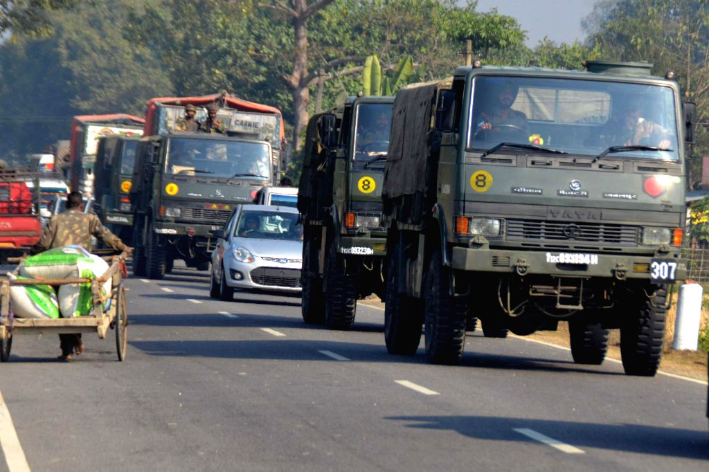 An army convoy proceeds towards violence hit Bodoland Territorial Area Districts (BTAD) of Assam, where 73 people lost their lives in an attack by Bodo militants, in Sonitpur district on ...