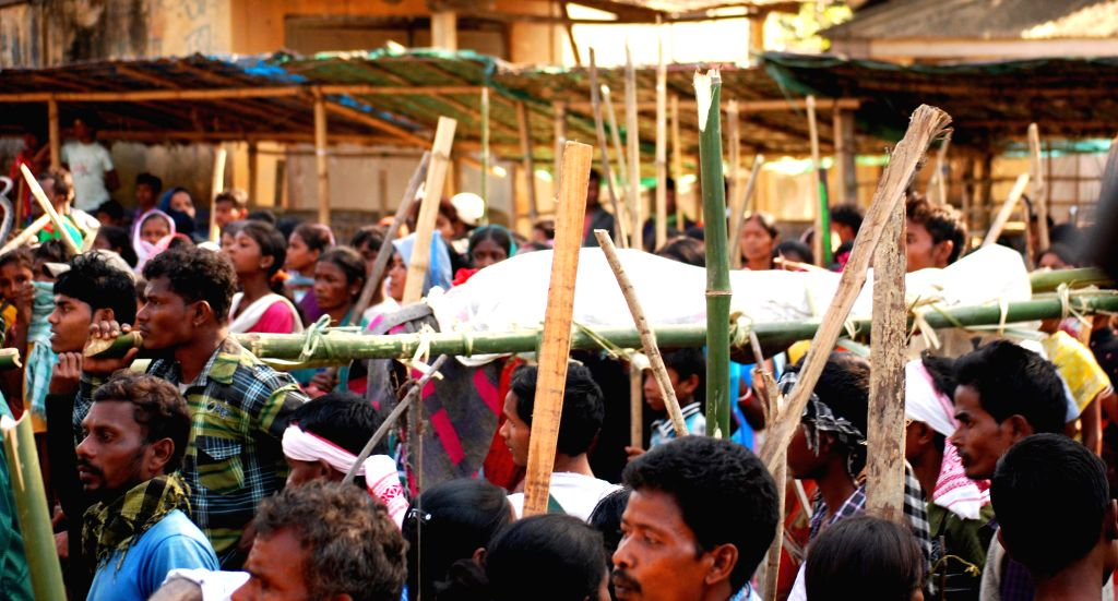 Armed protesters mostly villagers carrying dead bodies and dao protest on the streets of Dhekiajuli a day after Bodo militants massacred 65 unarmed tribals, in Sonitpur district of ...