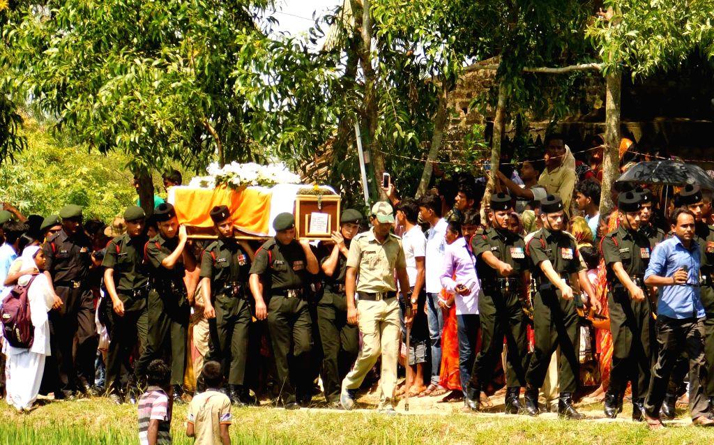 South 24 Parganas: Last rites of Uri martyr Biswajit Garai underway in South 24 Parganas of West Bengal on Sept 20, 2016.