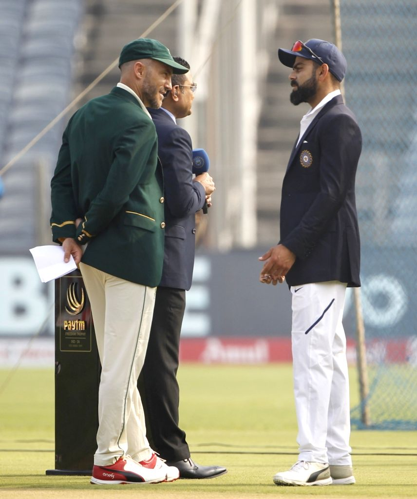 South Africa captain Faf du Plessis and Indian captain Virat Kohli during the toss before the second Test match in Pune on Oct. 10, 2019. - Faf and Virat Kohli