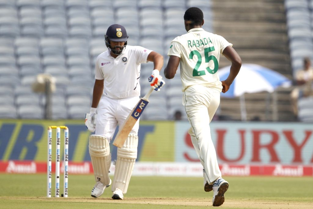 South Africa's Kagiso Rabada celebrates the fall of Rohit Sharma's wicket on Day 1 of the second Test match between India and South Africa at Maharashtra Cricket Association Stadium in Pune, on ... - Rohit Sharma