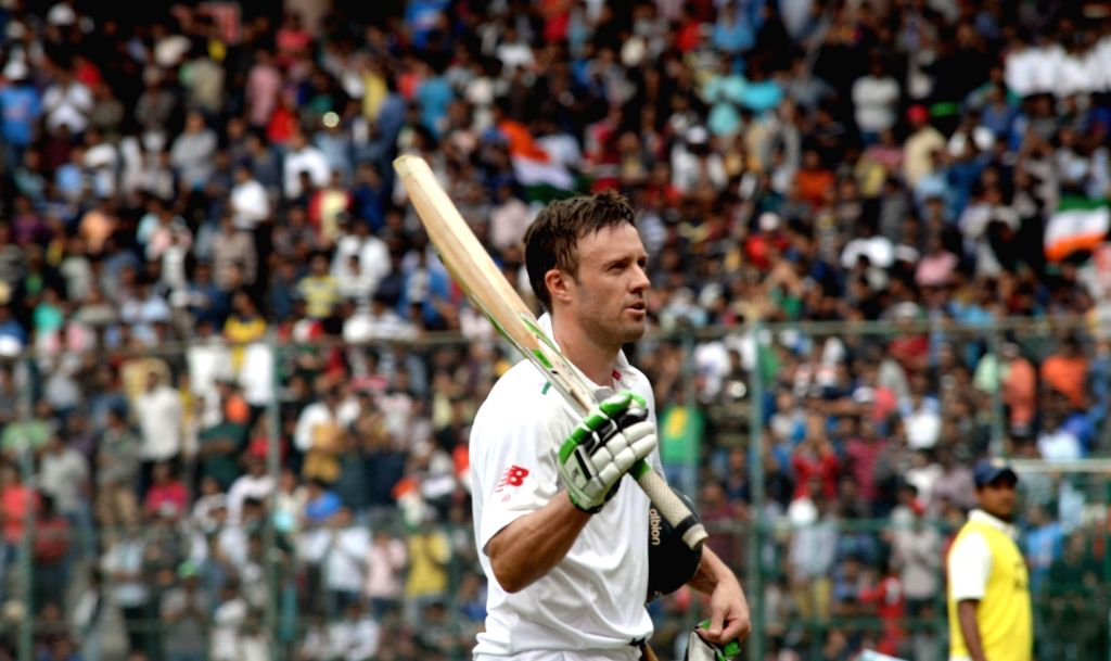 South African batsman AB de Villiers returns back to the pavilion after getting dismissed during the first day of the second test match between India and South Africa at M Chinnaswamy ...