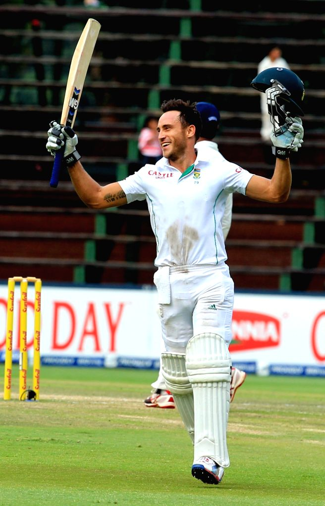 South African batsman Faf du Plessis celebrates his century during the 5th Day of the First Test match between India and South Africa played at New Wanderers Stadium in Johannesburg on Dec.22, 2013. - Faf
