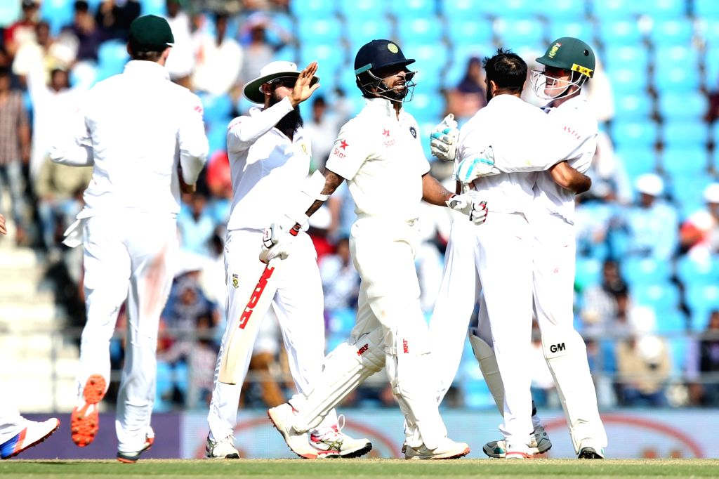South African cricketers celebrate fall of a wicket during the Day-2 of the third test match between India and South Africa at Vidarbha Cricket Association Stadium in Nagpur  on Nov 26, 2015.