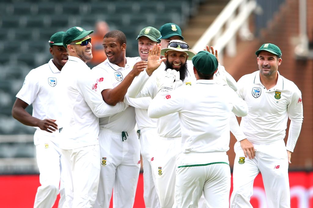 South African cricketers celebrate fall of Lokesh Rahul's wicket during Day 1 of the third Test match between South Africa and India at the Wanderers Stadium in Johannesburg, South ... - Lokesh Rahul