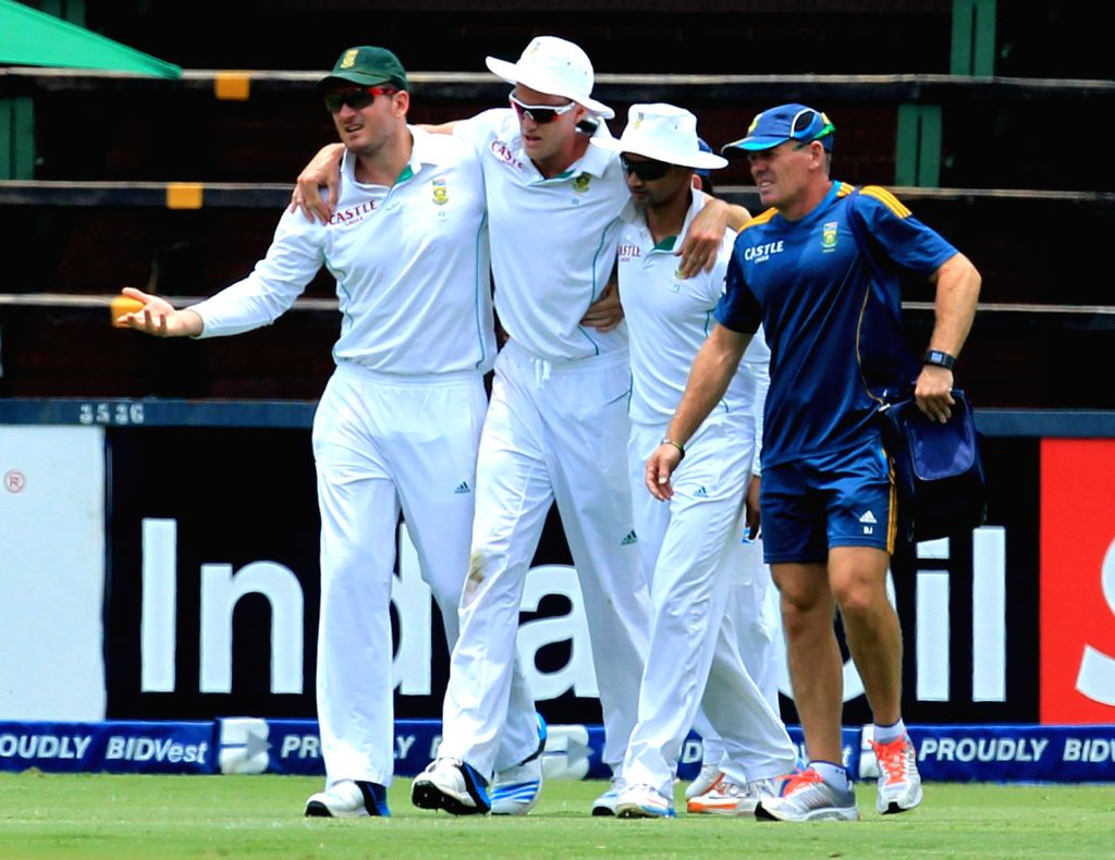 South African player Morne Morkel being taken to pavilion after getting injured during the 3rd Day of the First Test match between India and South Africa played at New Wanderers Stadium in ...