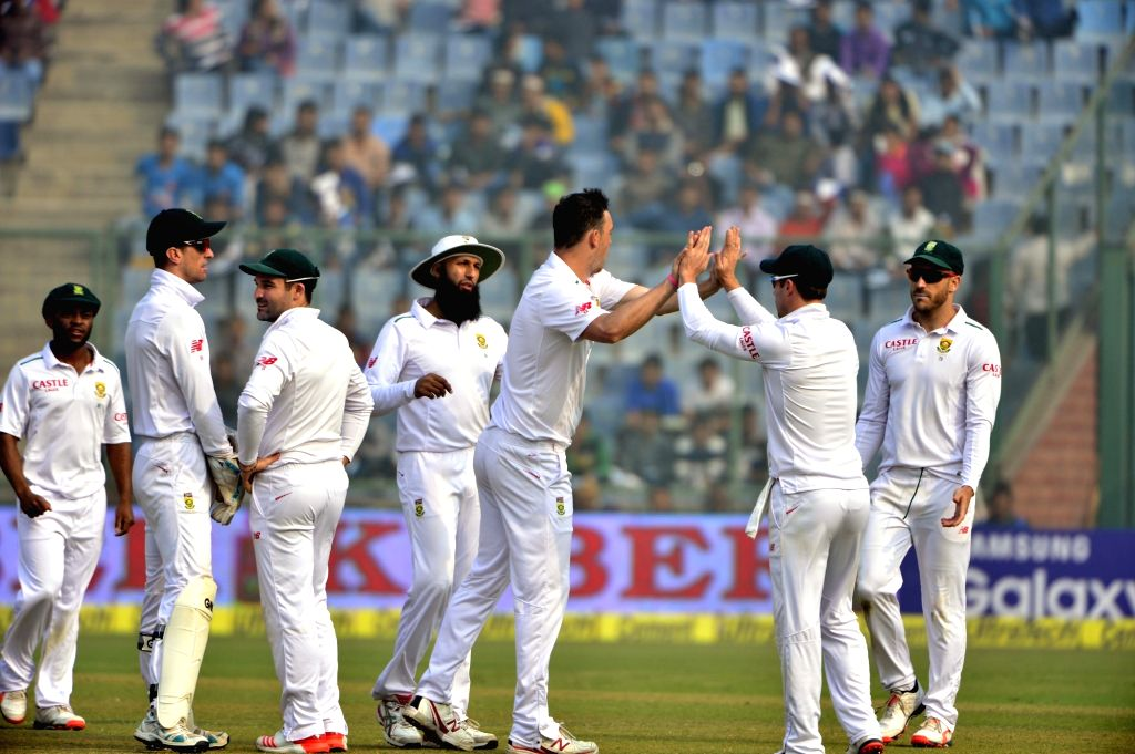 South African players celebrate fall of a wicket during the fourth day of the Fourth and the final test match between India and South Africa at the Feroz Shah Kotla Stadium in New Delhi on ...