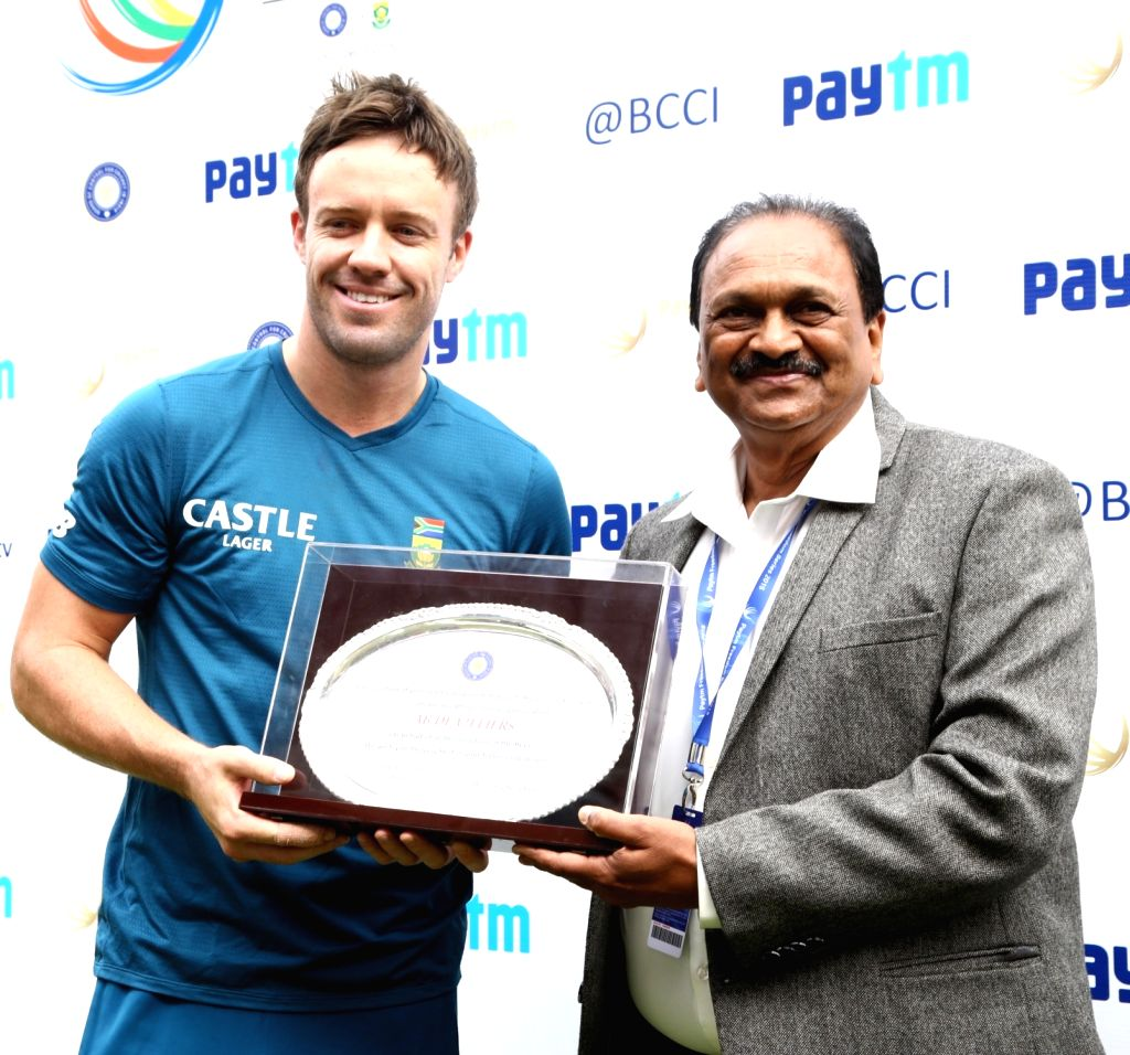 South Africas AB De Villiers being felicitated by BCCI Vice President G Gangaraju on his 100th test match during the first day of the second test match between India and South Africa at M Chinnaswamy ...