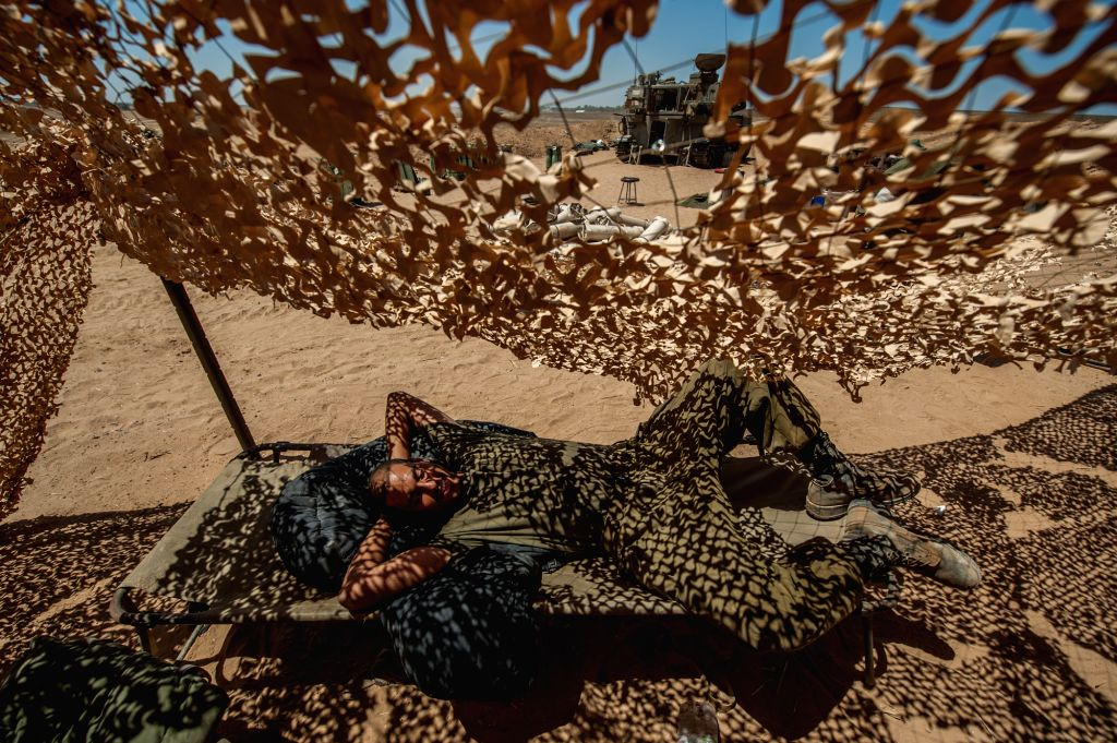 An Israeli soldier rests in southern Israel bordering the Gaza Strip, on Aug. 6, 2014. Israel has agreed to extend the ongoing ceasefire in the Gaza Strip with .