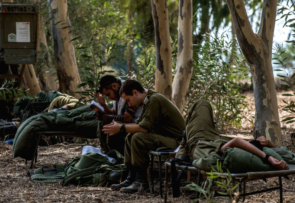 Israeli soldiers are seen in southern Israel bordering the Gaza Strip, on Aug. 6, 2014. Israel has agreed to extend the ongoing ceasefire in the Gaza Strip with